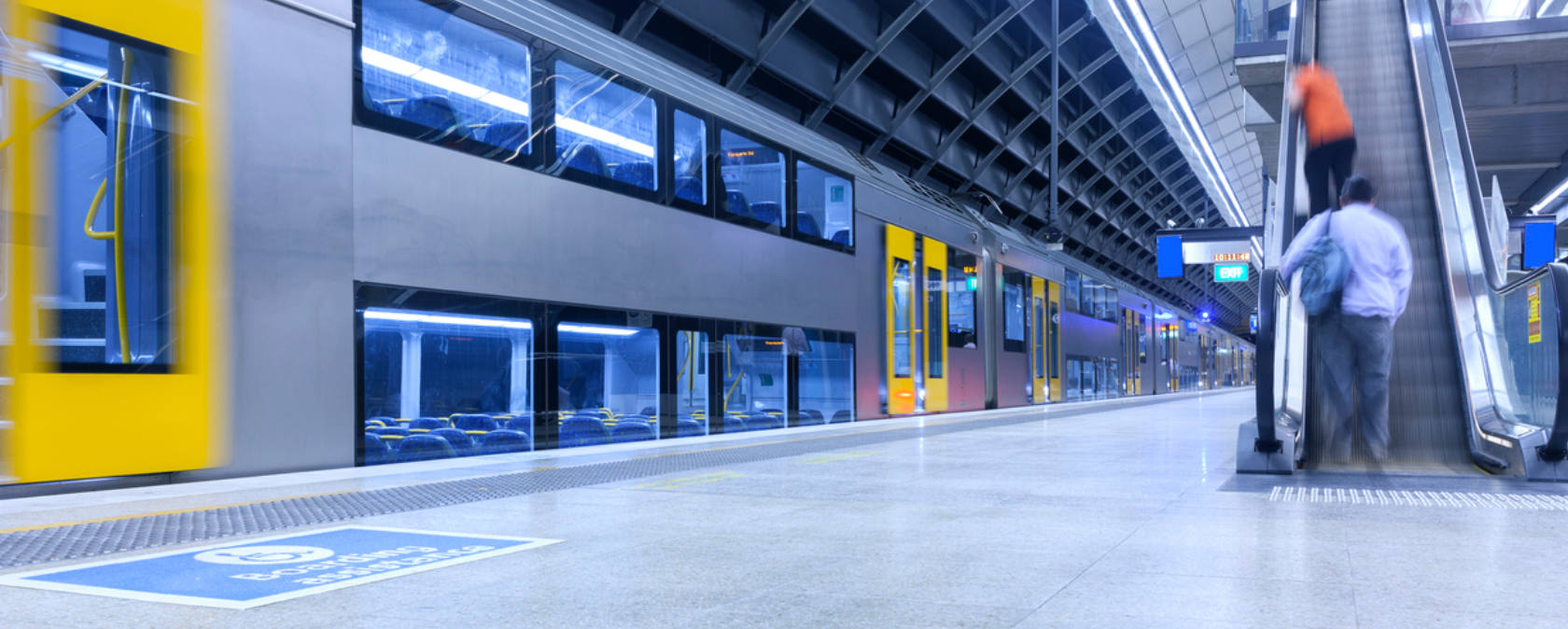 A train whizzes past a quiet train station platform