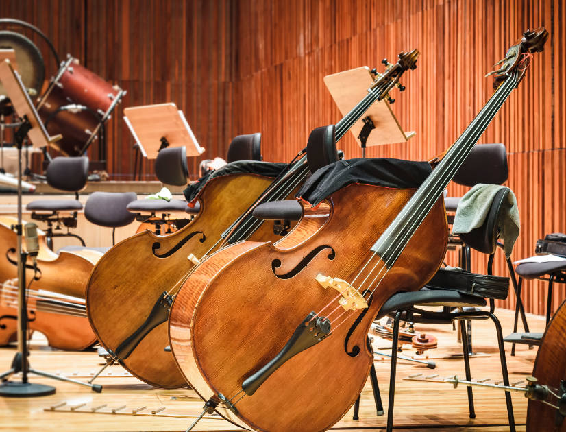 Cellos and other orchestral instruments waiting to be used