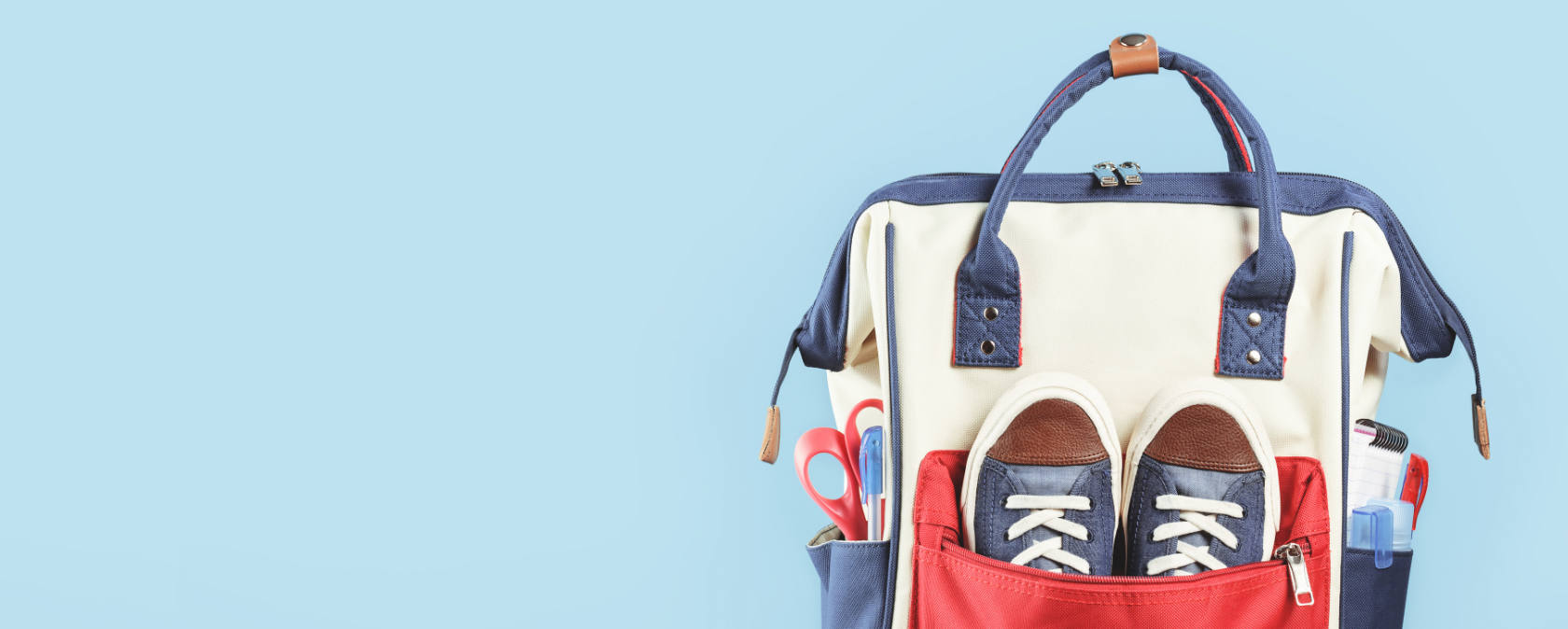 A red, white and blue schoolbag