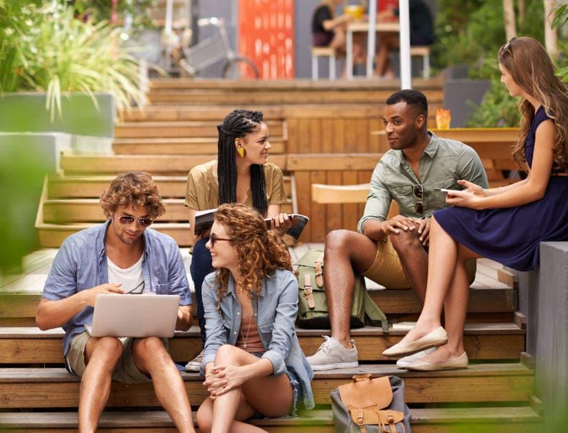 Students sitting on school steps